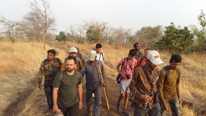 Naturalists trekking